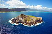 Hawaii, Oahu, Manana Island Aka Rabbit Island Mountains In Distance.