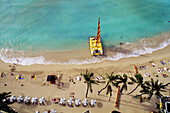Hawaii, Oahu, Waikiki Beach With Catamaran, Umbrellas And Vacationers On Beach, View From Above