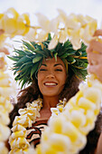 Close-Up Of Woman Holding Plumeria Lei Out In Front, About To Pass To C1489 Someone