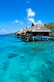 French Polynesia, Bora Bora Lagoon Resort Bungalows Over Water, Side View From Ocean C1782