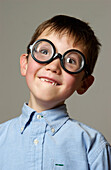 Boy Making Face In Glasses