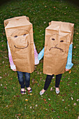 Sisters With Large Paper Bags Over Their Heads