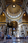Interior View Of The Dome And Baldachino, Bernini's Baroque Canopy Which Stands Above St Peter's Tomb Inside The Main Building Of Saint Peter's Basilica, Vatican City, Rome