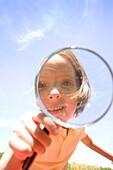 Girl Looking Through Magnifying Glass, Winnipeg, Manitoba