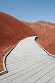 Boardwalk Through The Red Claystone Hills Of The Painted Cove Trail At The Painted Hills Unit Of The John Day Fossil Beds, Oregon