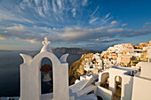View Of The Village Of Oia Perched On Steep Cliffs Overlooking The Submerged Caldera, Santorini, Greece