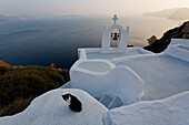 View From The Village Of Oia Perched On Steep Cliffs Overlooking The Submerged Caldera, Santorini, Greece