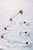 Christmas Tree Outlined In A Fresh Blanket Of Snow With Red Bulb Ornaments At The End Of The Branches And Gold Star At Top Winter Alaska