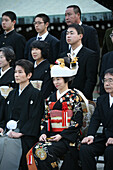'After The Traditional Japanese Shinto Wedding Ceremony Families Gather For A Formal Portrait Sitting, At Meiji Jingu Shrine; Near Harajuku Station; Tokyo. There Are Several Layers Of The Brides Kimono.The Groom's Ensemble Is Simpler, In A Traditional Shi