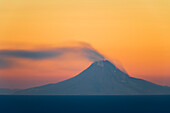 View of Mt. Augustine, active volcano, from Kachemak Bay, Homer, Alaska, winter