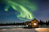 Aurora Borealis over Moose Creek cabin in the White Mountains National Recreation Area, Interior Alaska.