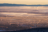 Ice fog hangs over the interior city of Fairbanks, Alaska on a chilly minus 40 degree fahrenheight day in January.
