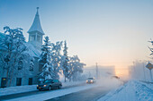 Vehicle traffic in ice fog in downtown Fairbanks during winter temperatures of minus 40 degrees, Interior Alaska