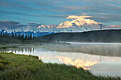 Early morning sunrise on the face of Mt. McKinley and Wonder Lake, Denali National Park, interior, Alaska.