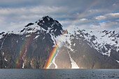 Rainbow arcs over Mt Curtis, Barry arm and the Chugach mountains, Prince William Sound, southcentral, Alaska.