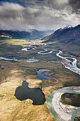 Aerial of the Noatak river flowing north west out of the Brooks range, in the Gates of the Arctic national park, Alaska.