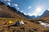 Campsite in the Arrigetch creek valley with a view of Xanadu (left) Arial and Caliban mountains, Brooks range, Gates of the Arctic National Park, Alaska.