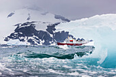 'Composite of the United States Coast Guard Heavy Icebreaker and icebergs in the Southern Ocean; Antarctica'
