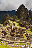 'Huayanapichu (young mountain) in the distance at Machu Picchu, the ancient lost city of the Incas, one of Peru's top tourist destinations; Peru'