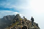 'Walkers on ridge near the top of Sgurr Alasdair in the Black Cuillin; Isle of Skye, Scotland'
