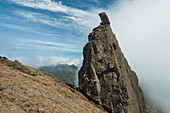 'People abseil off the Inaccessible Pinnacle at the summit of Sgurr Dearg; Isle of Skye, Scotland'