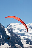 'Tandem paraglider flight above Chamonix-Mont Blanc valley, with Mont Blanc mountain in background; France'
