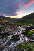 Scenic sunset view of a mountain stream at Summit Lake State Recreation Site, Hatcher Pass, Southcentral Alaska, Summer