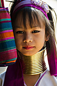 'Portrait of a young woman from the Long Neck Karenni hill tribe; Thaton, Chiang Rai, Thailand'