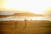 'Sun setting at Port Stewart Golf Club; Port Stewart, County Londonderry, Ireland'