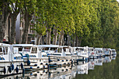 'Boats moored along the shoreline of the Canal du Midi; France'