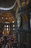 'Worshippers and tourists inside an Islamic mosque; Istanbul, Turkey'