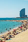 'A crowd on Barceloneta beach; Barcelona, Catalonia, Spain'