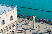 'High angle view of people in Piazza san Marco by the water; Venice, Veneto, Italy'