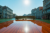 'Buildings along the shoreline of the Grand Canal viewed from a boat; Venice, Veneto, Italy'