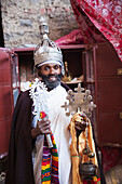 'Priest with crown and crosses, Nakuta Laab monastery, near Lalibela; Amhara region, Ethiopia'