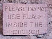 'A sign prohibiting the use of a camera flash inside the church, Beit Maryam rock-cut church; Lalibela, Amhara region, Ethiopia'