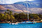 'Vistors leave sailing vessel Seasmoke after a cruise; Anaeho'omalu Bay, Island of Hawaii, Hawaii, United States of America'