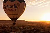 'A hot air balloon in flight at sunset; Cappadocia, Turkey'