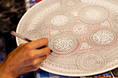 'Hand painting a decorative plate; Avanos, Cappadocia, Turkey'