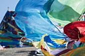 'Blessing colourful Tibetan prayer flags (Lung ta) under the blue sky; Tibet'