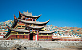 'Colourful Buddhist temple and many prayer flags and stupas at a Tibetan monastery near Hot Spring city; Madoi County, Tibet'