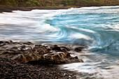 Hawaii, Maui, Hana, A soft slow view of ocean waves crashing on black lava rock