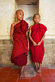 'Two novice monks standing in a Buddhist monastery, Upper Burma; Myanmar'