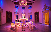 'A room glowing with pink light in Falaknuma Palace; Hyderabad, Andhra Pradesh, India'
