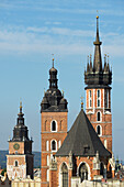 'Town Hall Tower, then the twin towers of St. Mary's Basilica, Old Town Square; Krakow, Poland'