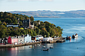 'Colourful buildings and boats in a harbour; Tobermory, Isle of Mull, Hebrides, Western Isles, Scotland'
