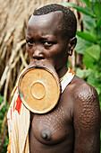 'Traditional scarring on Surma woman with lip plate, Omo region, Southwest Ethiopia; Kibish, Ethiopia'