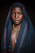'Young Suri (Surma) boy in a village, Omo region, Southwest Ethiopia; Kibish, Ethiopia'