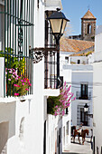 'A horse and rider on a narrow street between whitewashed buildings; Vejer de la Frontera, Andalusia, Spain'