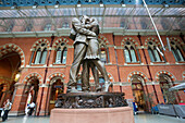 'St. Pancras Railway Station and statue of kissing couple; London, England'